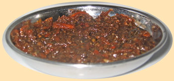 A bowl of Tamarind carrot chutney